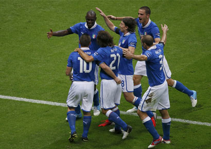 Italy's Mario Balotelli (L) celebrates with team mates after scoring a goal against Germany during their Euro 2012 semi-final soccer match at the National stadium in Warsaw.