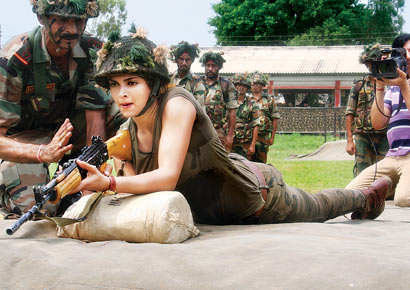 1729480 Deepika keeps promise; meets jawans despite sickness