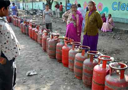 People stand in queue for LPG cylinders