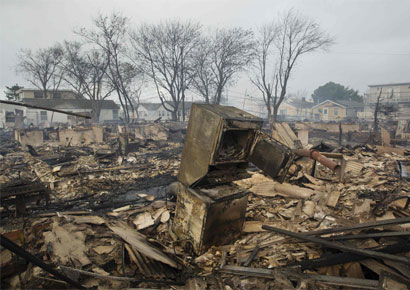 Homes devastated by fire and the effects of Hurricane Sandy at the Breezy Point section of the Queens borough of New York October 30, 2012