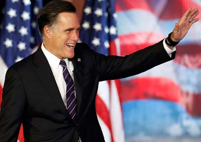 Mitt Romney waves before delivering his concession speech during his election night rally in Boston, Massachusetts on November 7, 2012