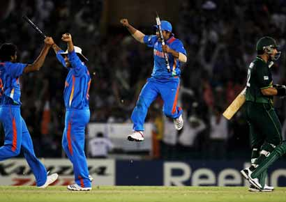 The Indian team celebrate victory over Pakistan during the 2011 ICC World Cup second Semi-Final