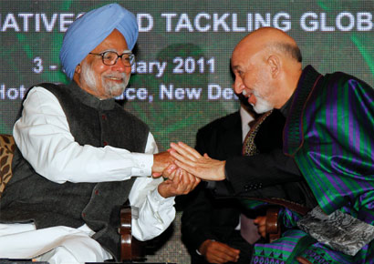 Afghanistan president Hamid Karzai (R) with prime minister Manmohan Singh at the 11th Delhi Sustainable Development Summit 2011 on Thursday, February 3, 2011