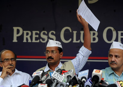 Arvind Kejriwal flanked by Prashant Bhushan and Manish Sisodia.