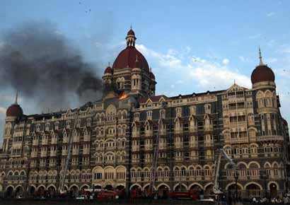 File photo of flames rushing out of the Taj Mahal Hotel in Mumbai on November 27, 2008. Up to 166 people were killed and around 100 more wounded in coordinated attacks by gunmen in Mumbai