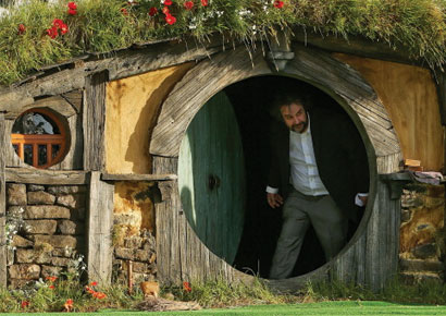 Director Sir Peter Jackson emerges from from a Hobbit house before delivering a speech at the <i>The Hobbit: An Unexpected Journey</i> World Premiere.