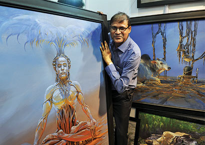 Nagpur-based artist Bijay Biswaal displays his acrylic paintings at the India Art Festival at BKC