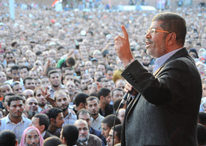Egypt president Mohamed Mursi addresses a public rally in Tahrir Square.
