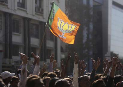 Supporters of BJP celebrate the victory of their party in Gujarat state assembly elections on Thursday in Ahmedabad.