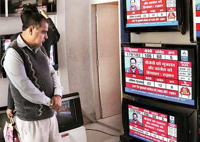 A man watches results of the Assembly elections at a TV showroom in Bikaner. The Congress has been out of power in Gujarat for two decades now.