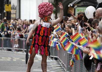 Revellers attend Manchester Pride 2012 in Manchester on August 24, 2012.