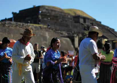 Pipil Mayans perform a dance during a ceremony at the Maya archeological site of Tazumal in Santa Ana