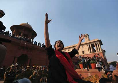 A demonstrator shouts slogans during a protest rally near the presidential palace in New Delhi.