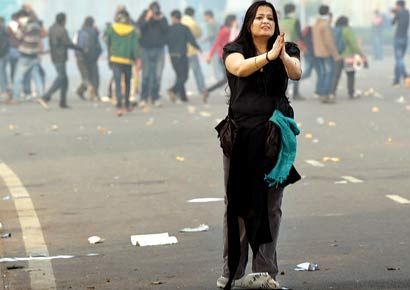 A girl pleads with the police not to use force during a protest at India Gate against the rape of a student in Delhi.