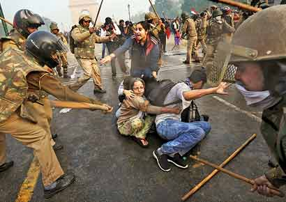 No discrimination: Police charge at protesters in New Delhi on Sunday.