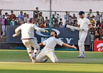 Mumbai's Abhishek Nayar celebrates after dismissing MP's Ishwar Pandey during their Ranji Trophy tie in Indore on Tuesday�DNA photo