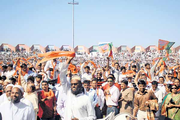 Muslims wave BJP flags as Narendra Modi takes oath at Sardar Patel Stadium in Gujarat