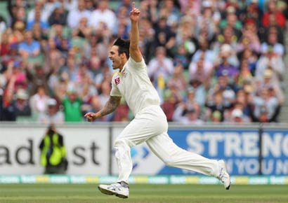 Mitchell Johnson celebrates the dismissal of Sri Lanka's Tillakaratne Dilshan during day three of the second Test between the two countries at Melbourne Cricket Ground on Friday.