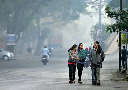 Girls enjoy a cold morning walk near Peshwe Park. Local conditions such as less humidity, clear skies and wind conditions are responsible for low minimum temperatures in the city