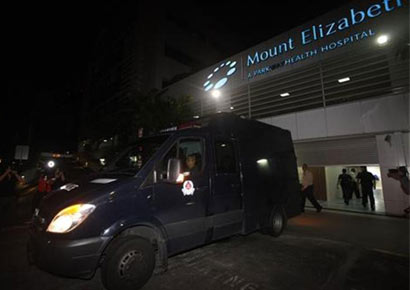 A police van carrying the body of the Delhi rape victim leave Mount Elizabeth Hospital for the morgue in Singapore December 29, 2012.