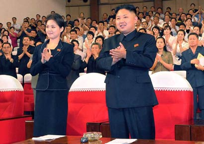 North Korea supreme commander Kim Jong Un enjoys a demonstration of the newly organised Moranbong band at an event in Pyongyang on July 6, 2012. The picture was taken by the Korean Central News Agency and released on July 9.