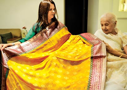 Meena Dholakia (left) is passionate about creating new saris from old ones. Her mother-in-law, Kusum Dholakia is happy her old saris are getting a new life