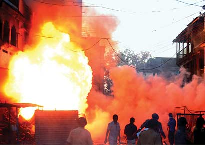Mobs set houses and shops on fire in Dhule on Sunday following a spar over cricket match that led to a riot