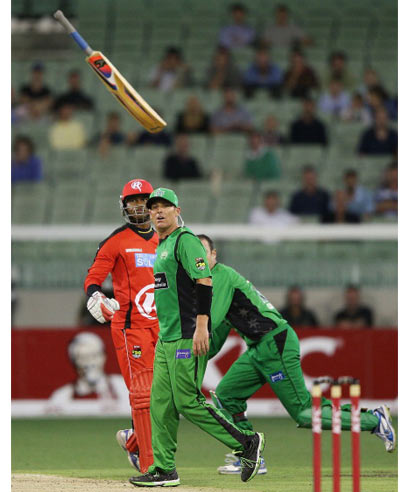 Marlon Samuels (L) of the Melbourne Renegades throws his bat in front of Shane Warne of the Melbourne Stars in a heated exchange during a Big Bash League match at Melbourne Cricket Ground on Sunday.