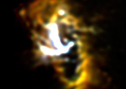 SOFIA/FORCAST mid-infrared image of the Milky Way galaxy's nucleus showing the Circumnuclear Ring (CNR) of gas and dust clouds orbiting a central supermassive black hole. The bright Y-shaped feature is believed to be material falling from the ring toward the black hole that is located where the arms of the