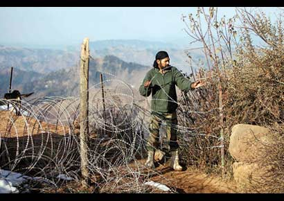 A soldier works near the Line of Control after reported ceasefire violation, in Mendhar, Poonch, in Jammu & Kashmir on Wednesday.