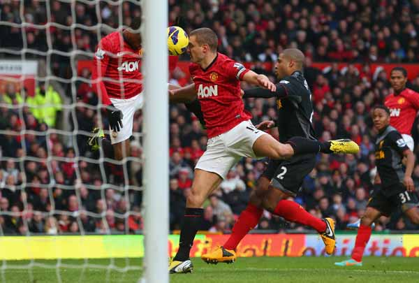 Nemanja Vidic of Manchester United scores the second goal from a deflected Patrice Evra header