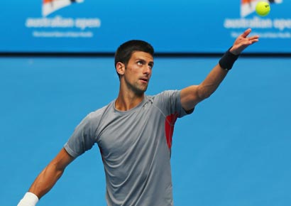 Novak Djokovic of Serbia serves during a practice session ahead of the 2013 Australian Open at Melbourne Park
