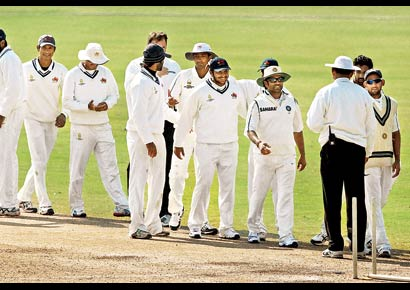 Mumbai players celebrate after securing the first innings lead over Services at Palam in New Delhi on Monday.