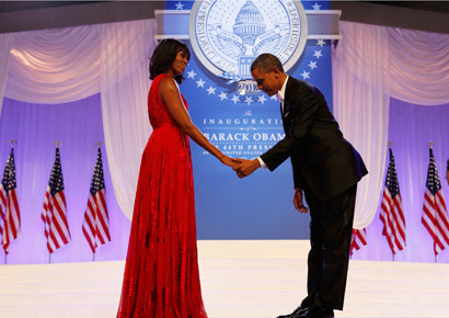 US President Barack Obama bows to First Lady Michelle Obama at the Inaugural ball in Washington, January 21, 2013.
