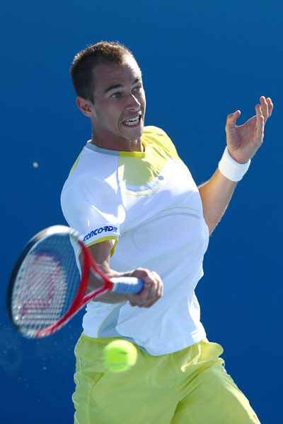 Lukas Rosol of the Czech Republic plays a forehand in his first round match against Jamie Baker of the UK on day two of the 2013 Australian Open on January 15, 2013.