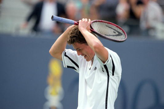 Marat Safin exults after beating Pete Sampras during the 2000 US Open.