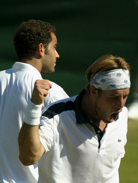 George Bastl of Switzerland celebrates his victory over Pete Sampras at the 2002 Wimbledon.