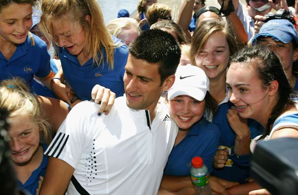 Novak Djokovic is hugged by fans following his victory at the 2008 Australian Open on January 28, 2008.
