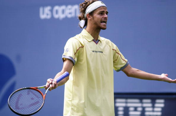 Gustavo Kuerten of Brazil reacts during his match at the 2000 US Open.