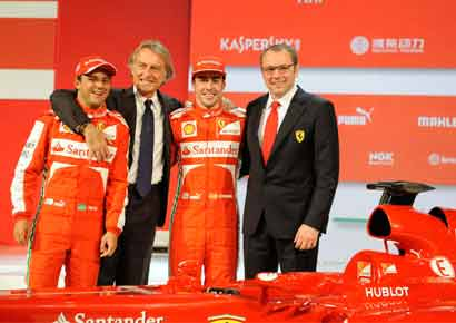 Ferrari boss Luca Cordero di Montezemolo (2nd L) poses with drivers Fernando Alonso (2nd R) of Spain, Felipe Massa of Brazil and  team principal Stefano Domenicali (R) during a presentation of the new Ferrari F138 Formula One car.