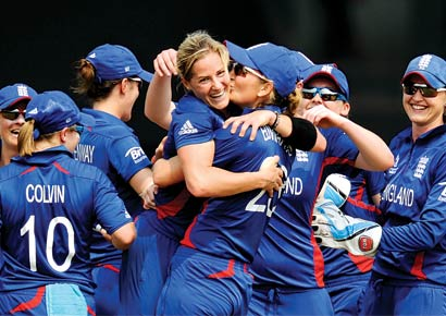 England skipper Charlotte Edwards embraces pacer Katherine Brunt, who dismissed India captain Mithali Raj
