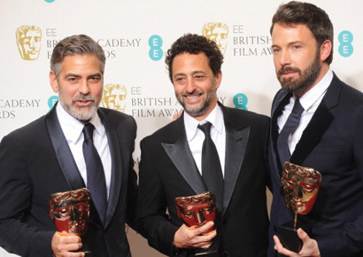 George Clooney, Grant Heslov and Ben Affleck, winners of the Best Film award for <i>Argo</i>, pose in the press room at the EE British Academy Film Awards at The Royal Opera House on February 10, 2013 in London, England.