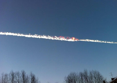 The trail of a falling object is seen above the Urals city of Chelyabinsk in Russia on February 15 in this picture provided by <i>www.chelyabinsk.ru</i>.