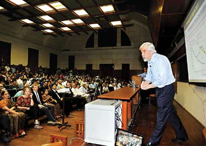 CERN director Rolf-Dieter Heuer engaging the audience during a lecture on the nature of the Higgs-Boson particle, at IISc on Saturday.