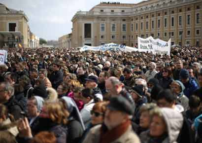 The faithful listen as Pope Benedict XVI delivers his last Angelus Blessing in Saint Peter's Square on February 24 in Vatican City, Vatican. The Pontiff will hold his last weekly public audience on February 27, 2013, before he retires the following day.