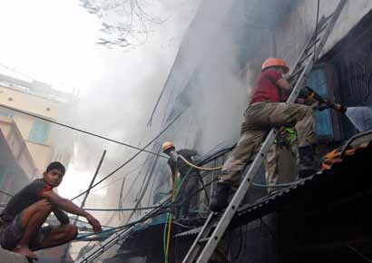 Fire fighters try to extinguish a fire at a multi-storey market complex in Kolkata on Wednesday. 