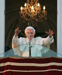 Pope Benedict XVI waves to pilgrims, for the last time as head of the Catholic Church, from the window of Castel Gandolfo where he will start his retirement on Thursday in Rome, Italy.