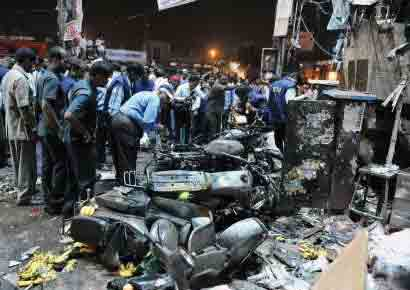 A file photo of investigators at the site of a bomb blast at Dilshuknagar in Hyderabad on February 21, 2013.