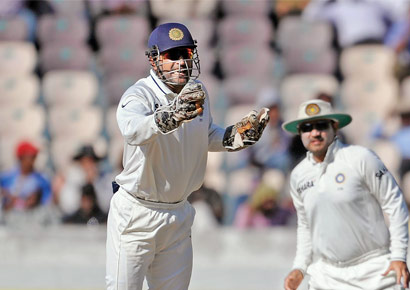 MS Dhoni is all smiles after David Warner is clean bowled by R Ashwin in Hyderabad on Monday