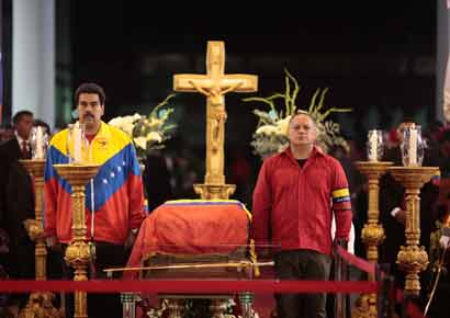Venezuela's Vice-President Nicolas Maduro (L) and National Assembly President Diosdado Cabello stand guard next to the coffin of late Venezuelan President Hugo Chavez during a wake at the military academy in Caracas on Thursday.